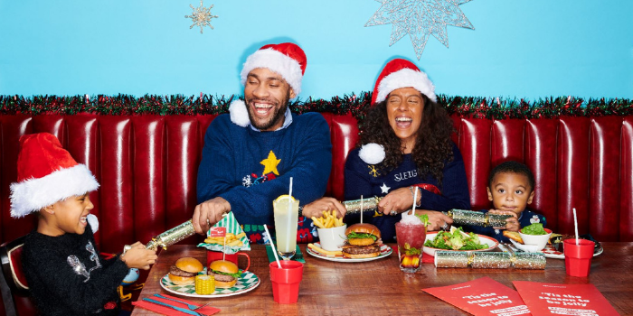 Family of 4 enjoying a festive meal at Frankie & Benny's
